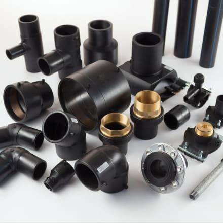 A layout of multiple black polyethylene fittings
