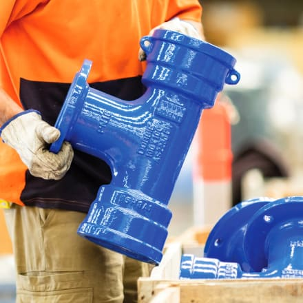 A ductile Iron pipe fitting handled in the warehouse
